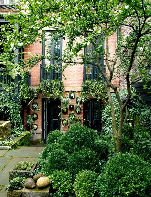 Several more photos at the link.  Two small courtyards by Sawyer Berson. Both in New York. Both lush, moist, marvellous. I can feel a faint mist in the air, a soft breeze ruffles the leaves in the trees while cool water naps carved stone. (You may recognise the second courtyard as Julianne Moore's.)