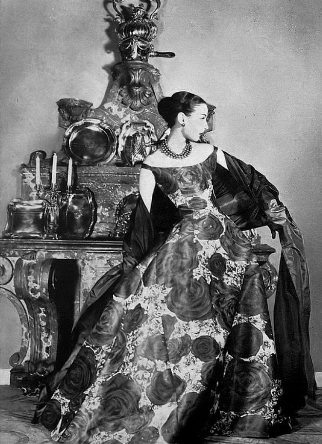 1955 Renée Breton in beautiful gown of dark brown roses printed on mist-colored silk organdy worn with dark brown taffeta stole by Christian Dior