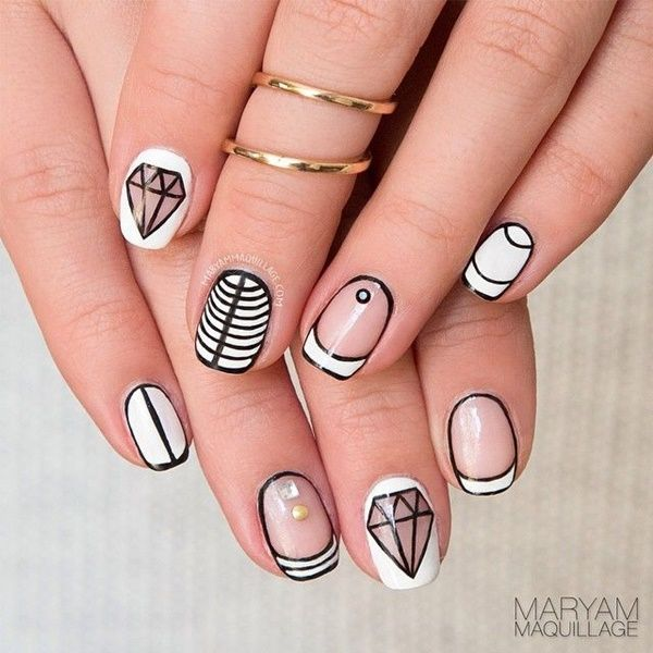 Modern Black & White stripes utilizing negative space and studs nail art: