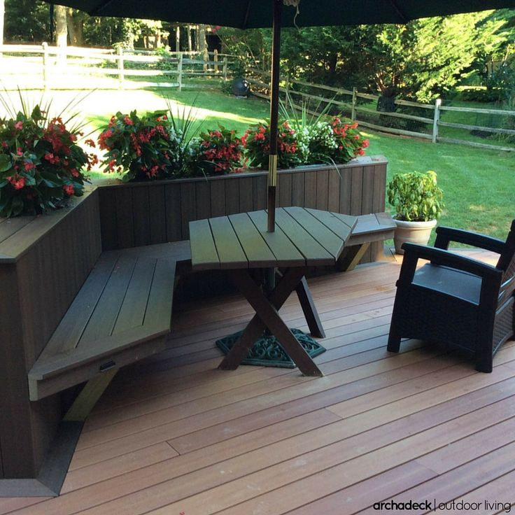 Deck With Built In Planters Incorporated Into The Back Of