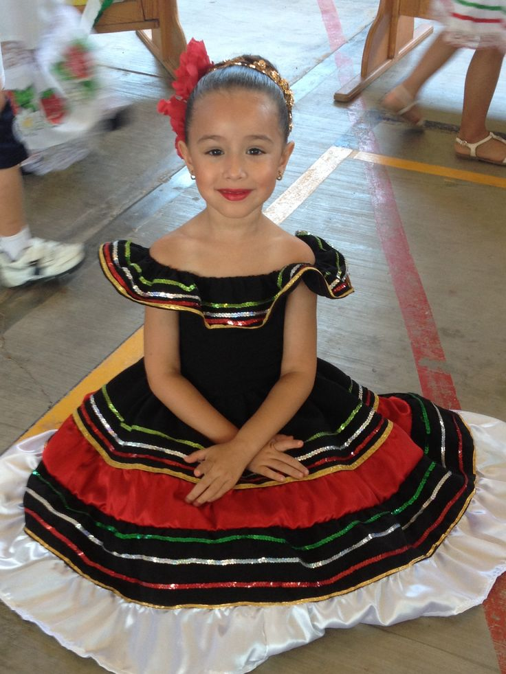 Beautiful baby girl in a pretty traditional Mexican dress