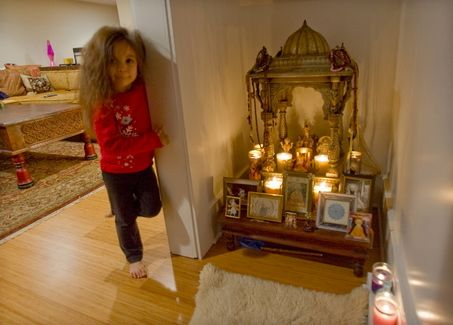 "Altared spaces: How to create a sanctuary in your home | ""Pritam Khalsa, 4, stands outside the tiny meditation room, which is tucked under the stairs."""