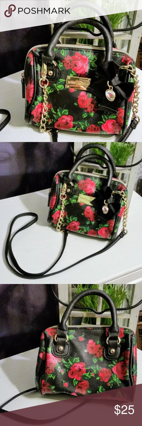 Betsey Johnson Rose Mini Purse Betsey Johnson Rose Mini Purse. Colors are black, red, green, and gold. Excellent condition. Can be used with handles or as a cross body purse. Great with any outfit.  SIZE 7 x 3 x 5 inches Betsey Johnson Bags