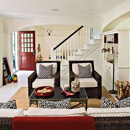 Classic Rattan Chairs And White Scheme In Small Living Room Under Stairs