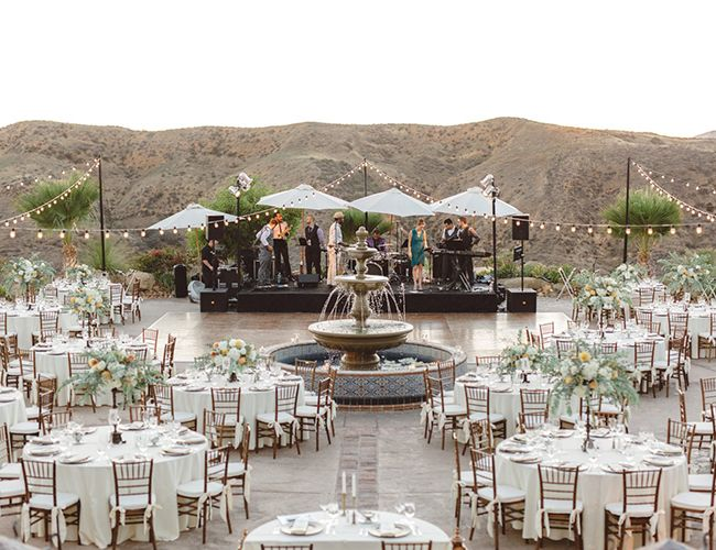 An orange and navy Hummingbird Nest Ranch wedding, this romantic affair was influenced by Italian heritage, and a desire for an elegant celebration that showcased the couple's creativity and love.