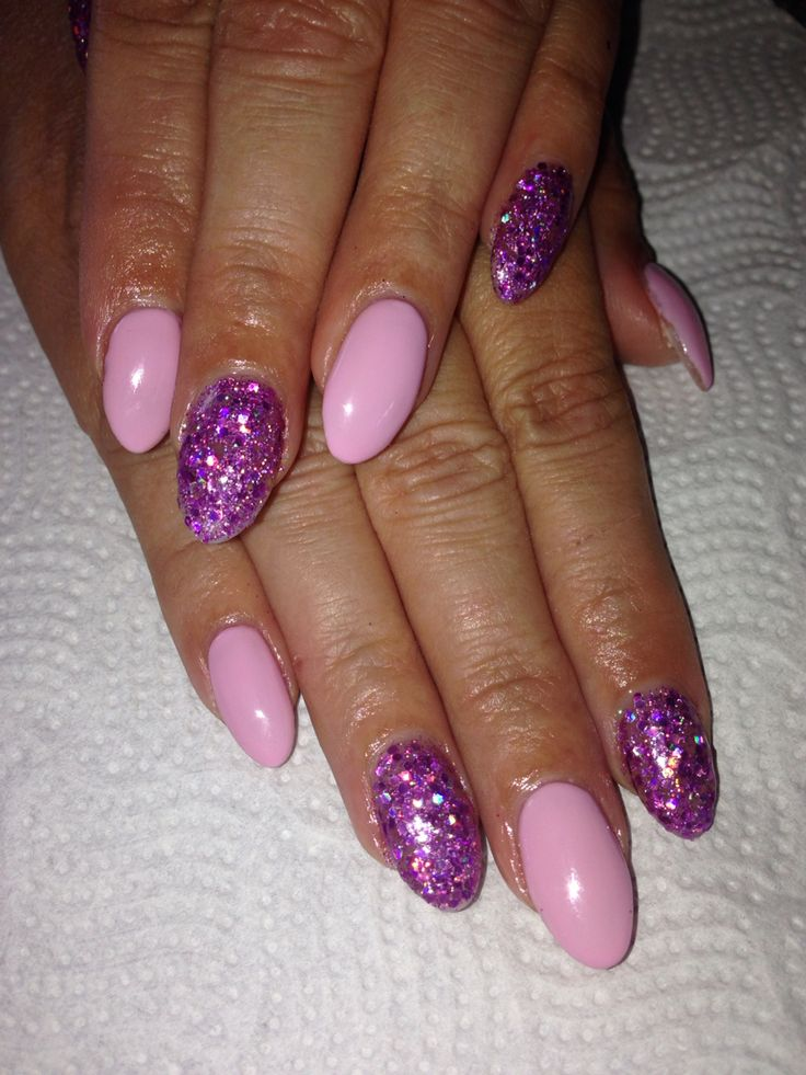 Pink gel polish and purple glitter acrylic nails