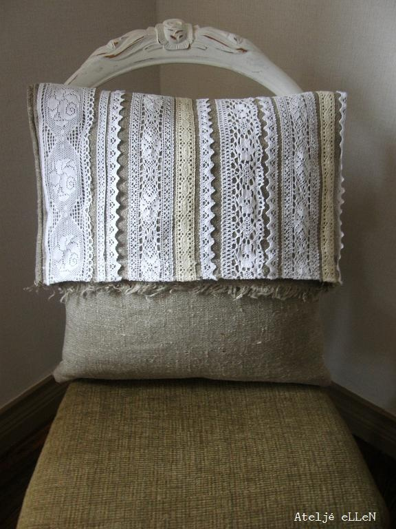 A cushion cover with lots of lace