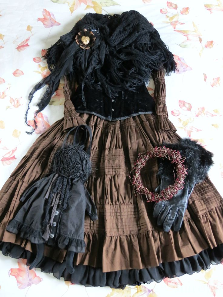 Strega's Forest. Dark Mori outfit. Black and brown. Folksy. Forest girl. Too many ruffles for my taste.