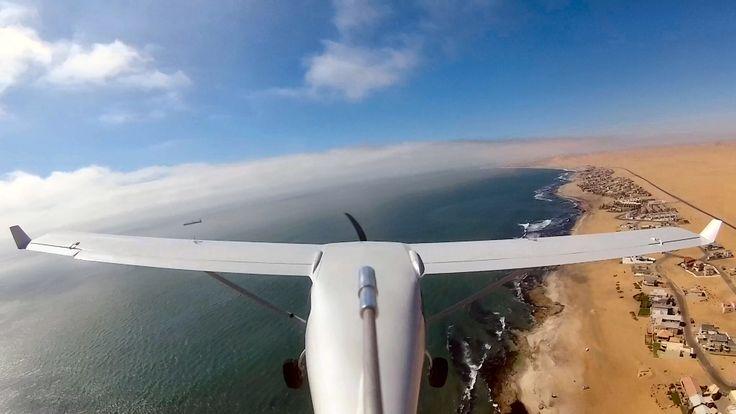 Jabiru flying along the Namibia coastline, Walvis bay. Namibia.