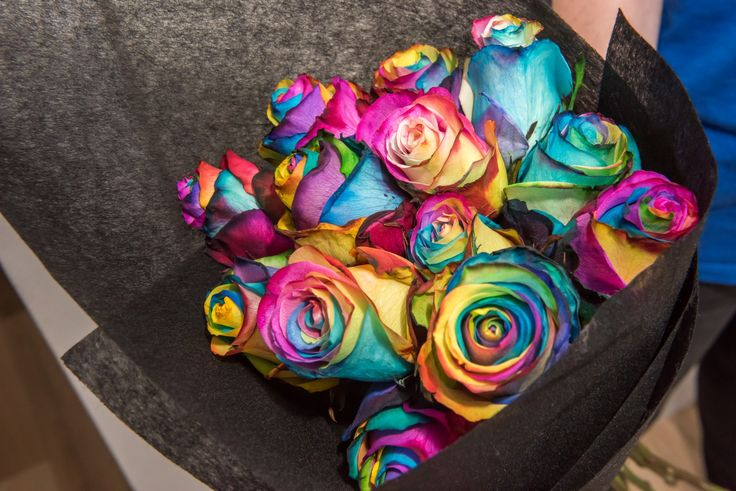 Wedding Photographer - Candid Photos of a Lifetime  This beautiful rainbow rose bouquet was in loving memory of all of the family members who were watching from Heaven.  They were handed out during the processional to various family members. xxx