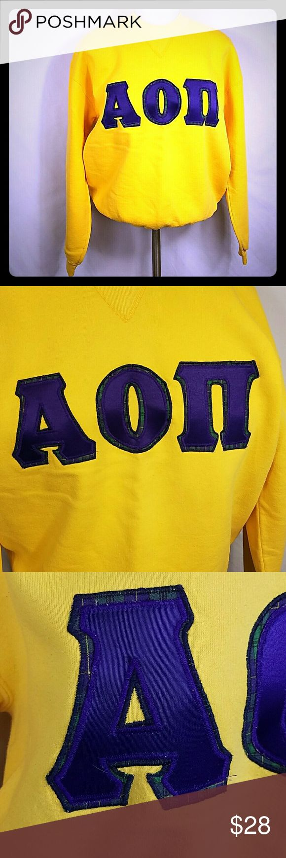 🆕 AOII Alpha Omicron Pi Letter Sweatshirt LSU Alpha Omicron Pi sorority letters sweatshirt. Sweatshirt is Russell sportswear size large and is a bright yellow color. Letters are purple on plaid. Double stitched letters professionally done while I was in college. Good condition but has a little pilling. LSU colors! Russell Tops Sweatshirts & Hoodies