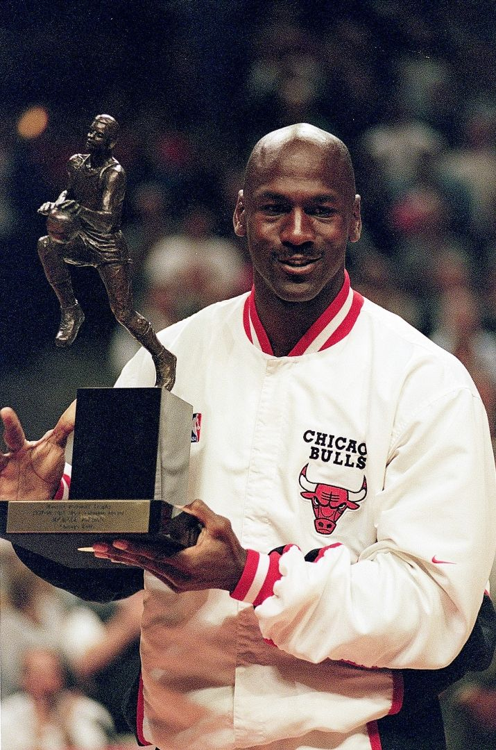 Michael Jordan of the Chicago Bulls holds up the MVP trophy before the  Eastern Conference game June