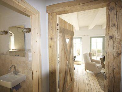 Strandhaus I Fehmarn auf Fehmarnsund: 2 Schlafzimmer, für bis zu 4 Personen. Liebevoll eingerichtetes Strandhaus mit Meerblick, in Südlage direkt am Strand | FeWo-direkt