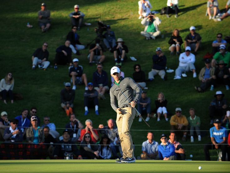 Rory McIllroy reacts after he putts on the 18th hole green during the second round of the Northern Trust Open golf tournament at Riviera Country Club.  Gary A. Vasquez, USA TODAY Sports