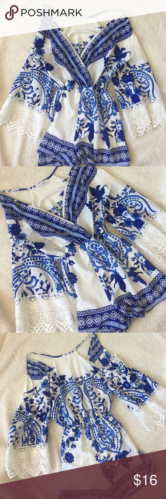 Beautiful blue and white romper This gorgeous blue and white romper will have all of your friends in envy. From the delicate detail of the lace on the sleeves, to the royal blue floral designs, this romper is the definition of gorgeous! Ces Femme Other