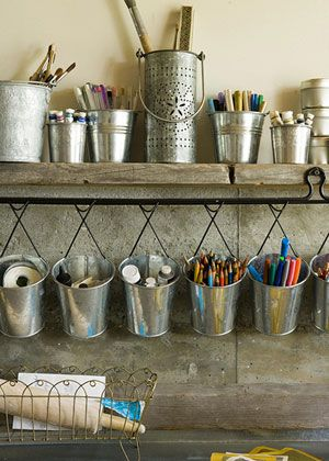 Galvanized tins can be used as an effective storage solution for smaller, miscellaneous items such as pencils, markers, and paintbrushes.