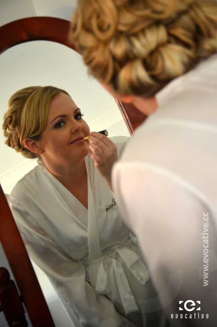 The bride looking in the mirror as she applied lipstick prior to putting on her wedding dress. #WeddingPhotography