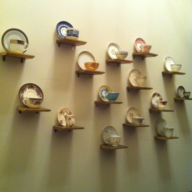 My most favorite wall in my entire home! The shelves are actually spray-painted floor molding that I bought & had cut at Home Depot. They're held up by gold brackets that I got there as well. My Grandmother gave me her tea cup collection-- bringing the project's grand total to around $20!