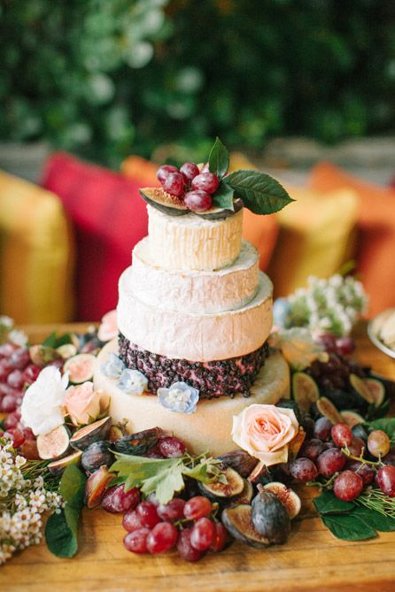 """Cheesecake"" made of cheese wheels and served with grapes, figs, chutney and crackers, assembled and decorated by Soho Beach House  