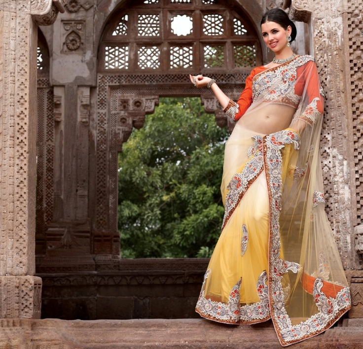 Dual color shaded saree in yellow and cream, crafted on net, dupian and satin material.    For more details visit www.ashika.com
