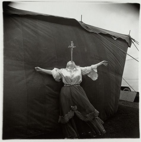 Albino sword swallower at a carnival, Maryland, 1970 by Diane Arbus