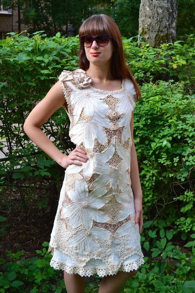 A crocheted with embroidery dress  with using pieces of tissu