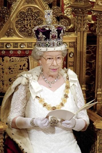 Britain's Queen Elizabeth II addresses her speech to the House of Lords during the State Opening of Parliament 06 December 2000. The speech outlines details of what the British government hopes to achieve in the next parliamentary session. (Photo credit JOHN STILLWELL/AFP/Getty Images)