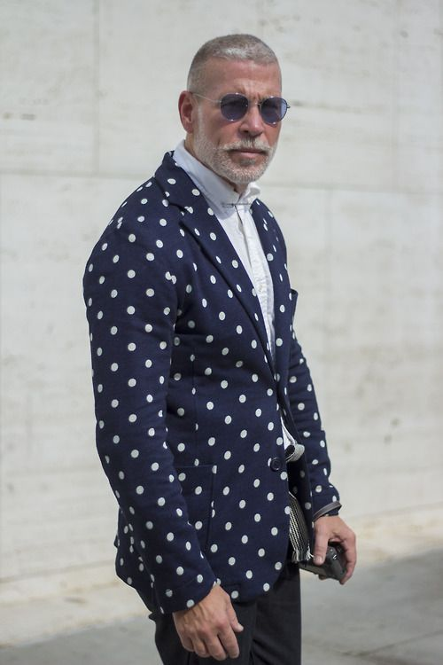 Make a deep blue polka dot blazer and black chinos your outfit choice if you're going for a neat, stylish look.  Shop this look for $38:  http://lookastic.com/men/looks/navy-blazer-and-white-longsleeve-shirt-and-black-chinos/643  — Navy Polka Dot Blazer  — White Longsleeve Shirt  — Black Chinos