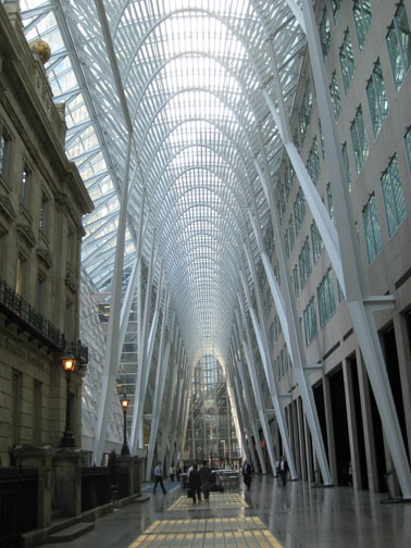 """The Galleria, 181 Bay Street, Financial District, connects Bay with Yonge Street. Architect – Santiago Calatrava. The """"hall of light"""" is five storeys high and runs parallel to Front Street. One floor below is a connection to the Hockey Hall of Fame. First class art and cultural events are often presented here."""