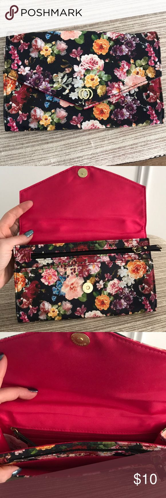 Floral clutch bag Floral clutch bag with lots of hidden pockets and zippers and a very handy card holder built into bag Bags Clutches & Wristlets
