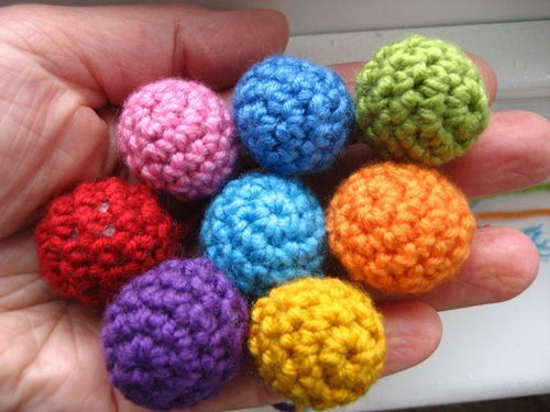 Attic24: Little Balls - these are actually really fun to make.... also wondering whether fastening off instead of closing I would end up with cute little hats for daughter's doll house people, could even add a little Pom Pom on top perhaps?