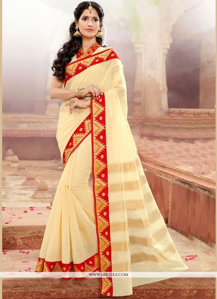 This delightful diva accoutre features unique styling and unusual material. Get the simplicity and grace with this cream khadi silk traditional  saree. The lovely patch border work throughout the atti...