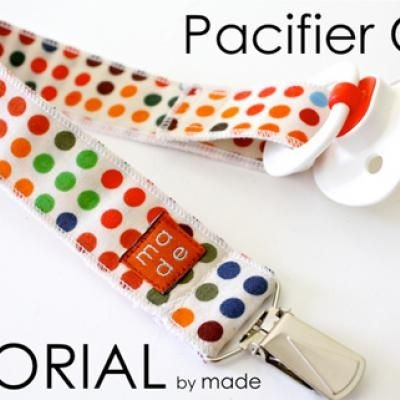 DIY pacifier clip.  So easy and cute! Great idea to add to the baby shower gift