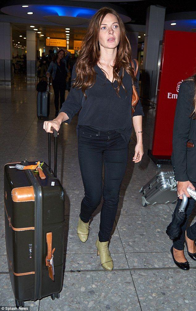 Long day: Earlier on Saturday Rebecca was seen landing in London Heathrow