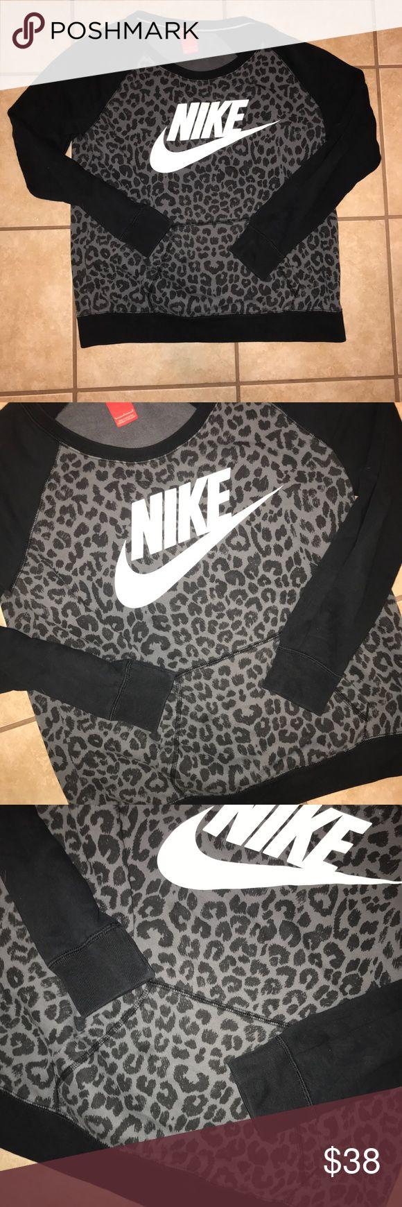 Nike Leopard print pullover sweatshirt Beautiful Nike leopard print pullover. It's in like new condition. Has a front pocket (like a hoodie). Nike Tops Sweatshirts & Hoodies