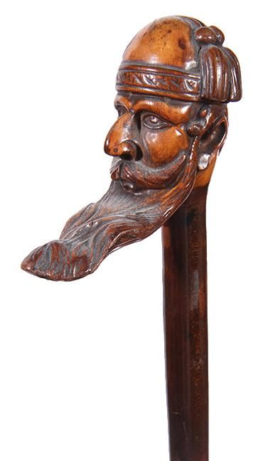 316. Folk-Art Man Cane – Ca. 1900 – A detailed carving of a man in a large mustache and long beard in a fez with a pair o - Current price: $250