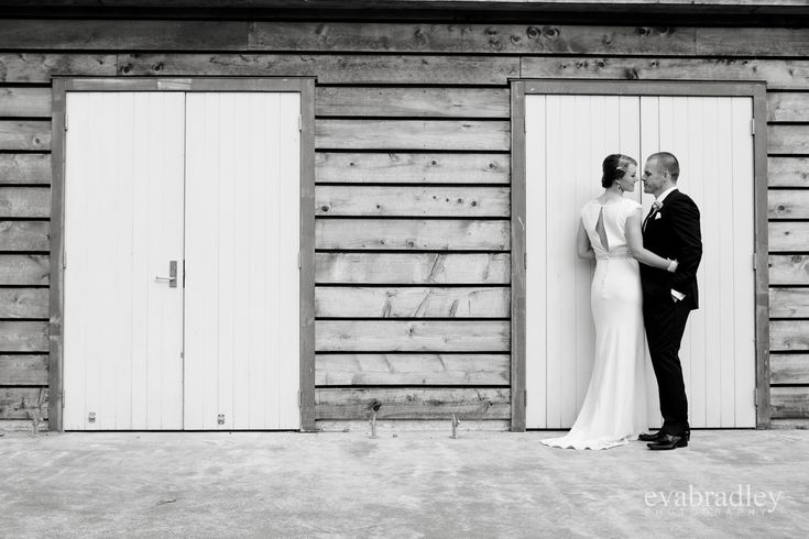 Couple shot to showcase back of dress - note posing - groom's hand in pocket so it doesn't cover dress, bride's hand on waist for same reason.  Tanya & Mal   Te Awa Winery wedding by Eva Bradley by Hawkes Bay wedding photographer Eva Bradley Photography