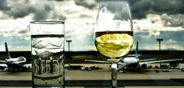 """The Ultimate List of Airlines That Serve Free Alcohol.  But remember, as Johnny Jet says, """"One drink in the sky is equivalent to two on the ground and dehydration happens much faster.""""  http://www.johnnyjet.com"""