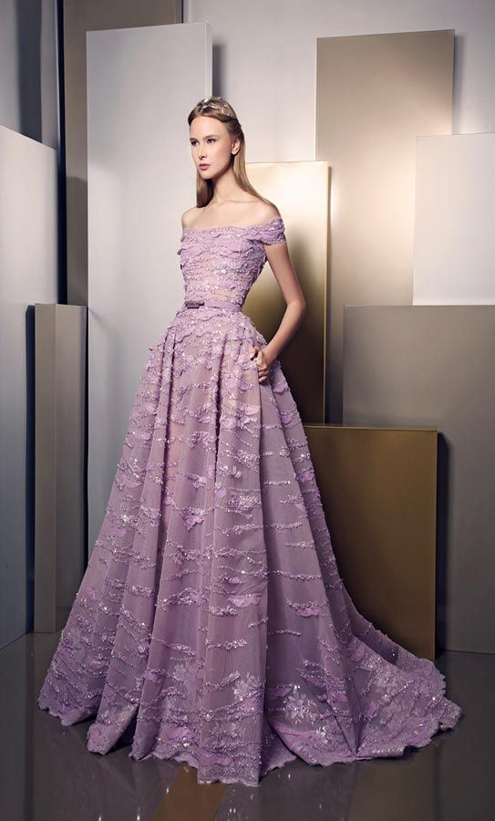 Ziad Nakad Summer 2016 | Mauve off the shoulder gown & with  belt, with a unique textile featuring periodic horizontal stripping, and full skirt.