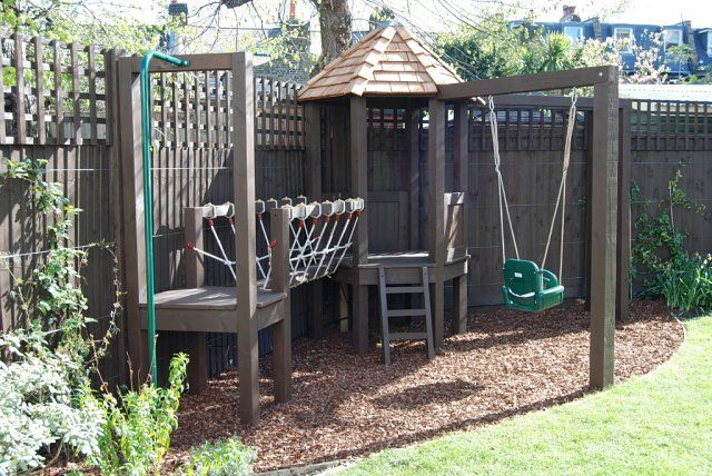 Playframe with rope bridge, play house, monkey bars, swing, fireman's pole