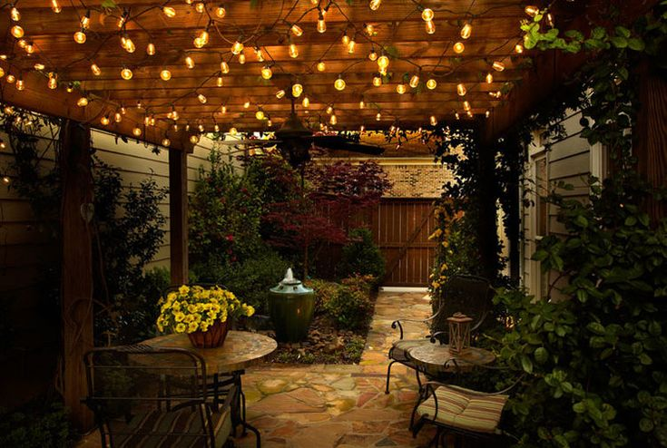 hang bistro lights under a covered deck for cozy outdoor dining.