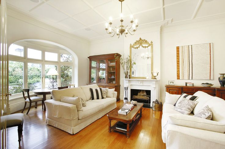 Living area, white walls, arched windows, period features, fire place, chandelier,   Constructed by Classic Projects