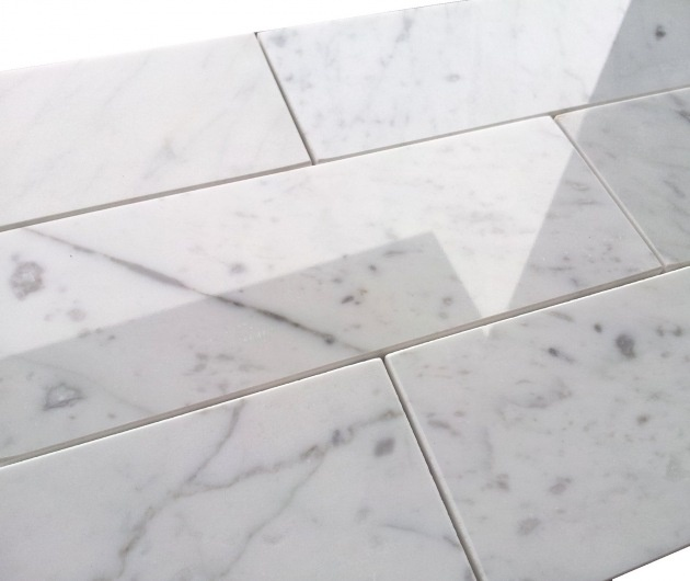 need to pick my grout color for our carrara marble tile backsplash in the kitchen we are having absolute black countertops install as well