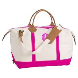 """Whether you're jetting off on business or visiting family for the weekend, travel in style with this essential canvas overnight bag, featuring ample storage space, a detachable shoulder strap, and pink trim.      Product: WeekenderConstruction Material: Cotton canvas and leatherColor: PinkFeatures:  Detachable strapZippered closureDimensions: 15"""" H x 28"""" W x 10"""""""