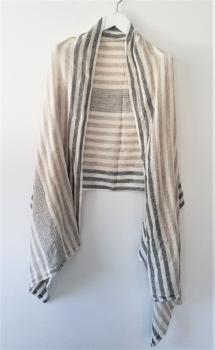 Nothing says luxury like a fine fiber and cashmere is one of the finest. Our lightweight cashmere shawl epitomizes luxury and comfort and will make you feel chic wherever you float. Hand woven in the Himalayan mountains by skilled artisans, this finely woven shawl will wrap softly around y