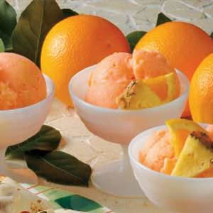 Pineapple Orange Sherbet Recipe -I uses an ice cream maker to create delightful sherbet that's low in fat and high in demand.—Angela Oelschlaeger, Tonganoxie, Kansas