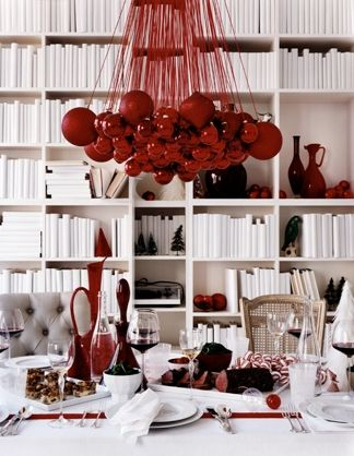 Christmas ornaments and matching ribbon make a passive chandelier. Color-coordinate for any holiday or color scheme.