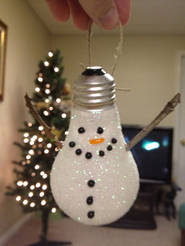 Light Bulb Snowman - paint on thinned glue and cover with glitter; use puffy paint for features and glue small twigs for arms. Could glue a scarf between buttons and mouth so it would stay in place.