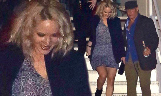 Jennifer Lawrence helped down stairs by Woody Harrelson at Adele show