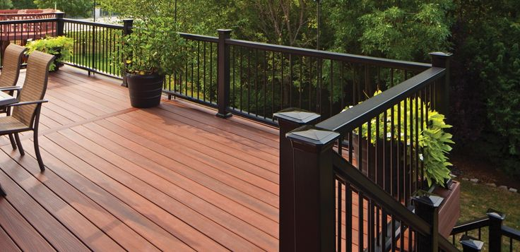 Horizon composite decking and railing shown in rosewood for Horizon composite decking